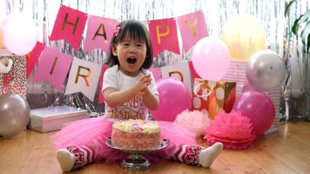 baby girl celebrating her second birthday at home - princess stock videos & royalty-free footage