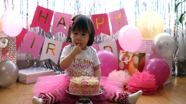 baby girl celebrating her second birthday at home - number 2 stock videos & royalty-free footage