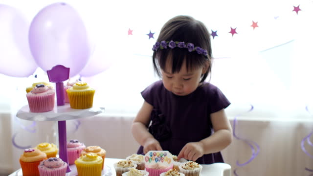 baby girl celebrating her second birthday at home