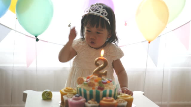 baby girl celebrating her second birthday at home - birthday stock videos & royalty-free footage