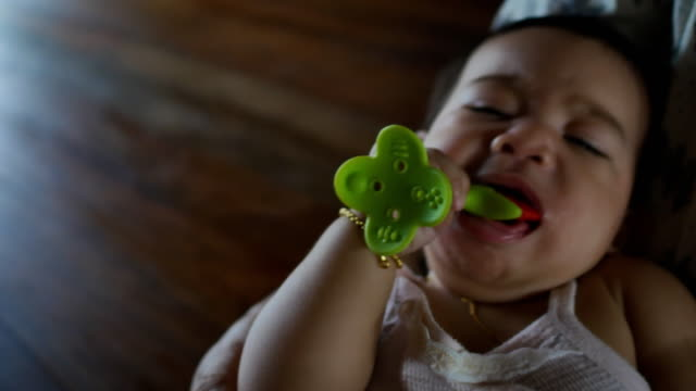 baby girl chewing toy - only baby girls stock videos & royalty-free footage
