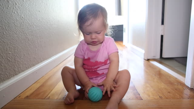 a baby girl climbing up and playing at the top of a small set of stairs indoors. - one baby girl only stock videos & royalty-free footage