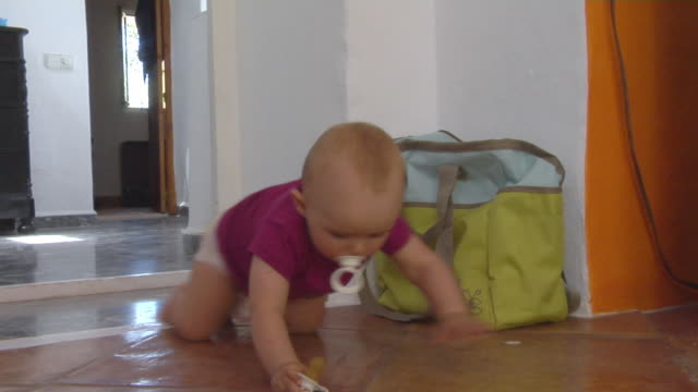 ms baby girl (6-11 months) crawling on floor, ibiza, spain - 6 11 months stock videos & royalty-free footage
