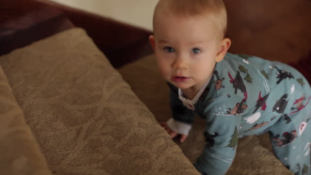 CU SELECTIVE FOCUS Baby girl (6-11 months) crawling up stairs / New York City, New York, USA