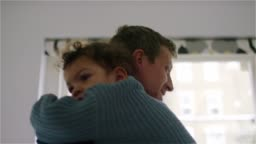 Baby girl dancing and cuddling with her father