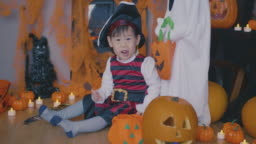 baby girl dressed up playing at Halloween party