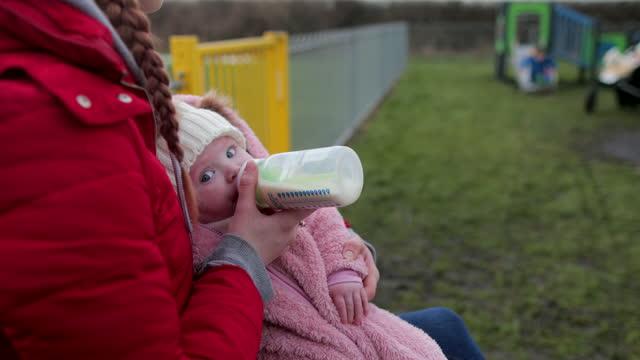 baby girl drinking milk bottle - innocence stock videos & royalty-free footage