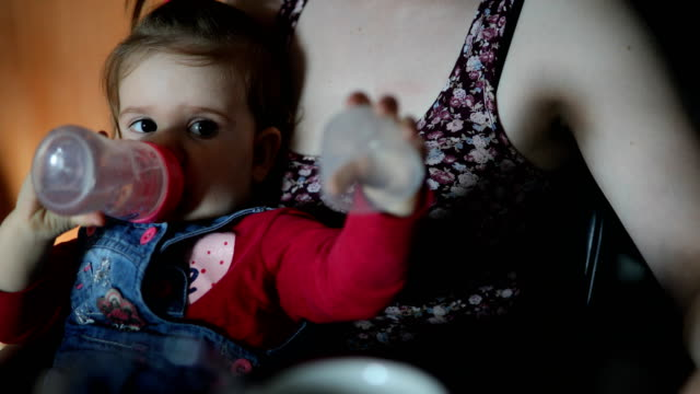 baby girl drinking water from the bottle - unrecognizable person stock videos & royalty-free footage