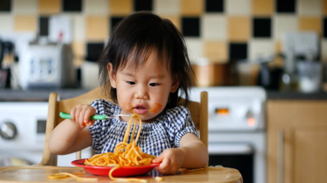 baby girl eating messy spaghetti - spaghetti stock videos and b-roll footage