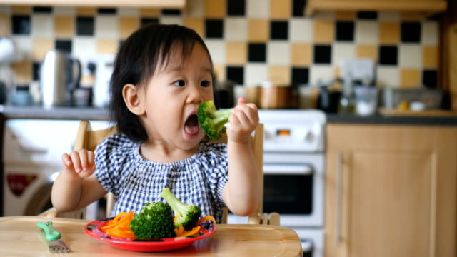 baby girl eating vegetable - broccoli stock videos & royalty-free footage