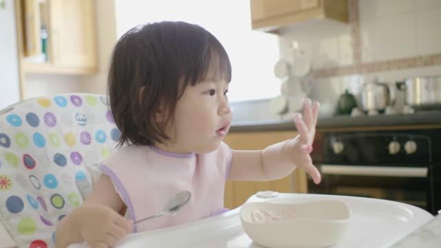 baby girl eating yoghurt - yoghurt stock videos & royalty-free footage