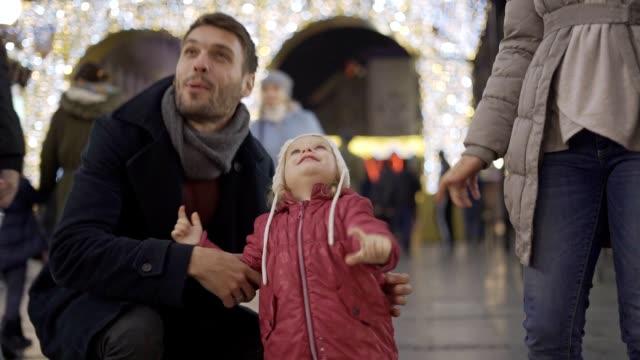 baby girl enjoying christmas lights - christmas market stock videos & royalty-free footage