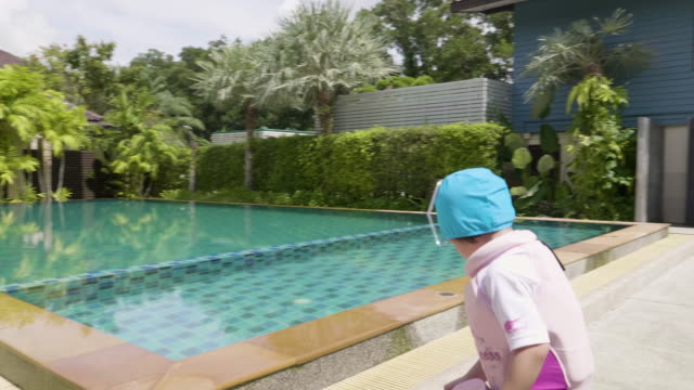 baby girl enjoying in swimming pool - one piece swimsuit stock videos & royalty-free footage