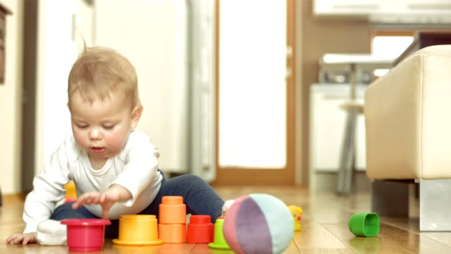 baby girl exploring block toys - one baby girl only stock videos & royalty-free footage
