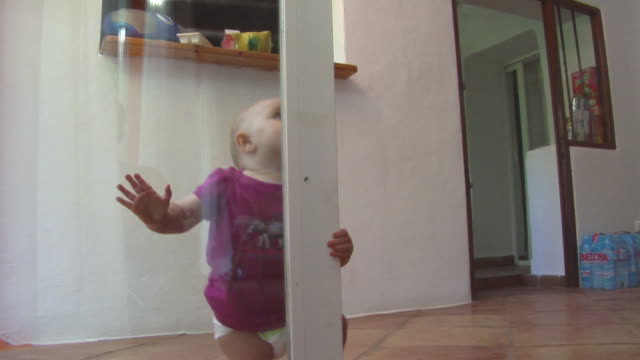 ms baby girl (6-11 months) getting up at glass door, ibiza, spain - 6 11 months stock videos & royalty-free footage