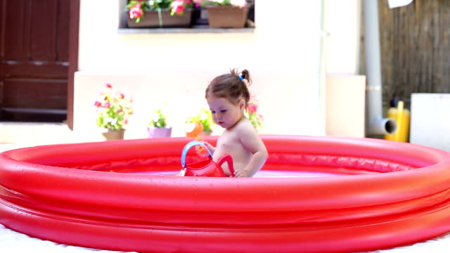 baby girl having fun on a hot summer day with her mother - baby girls stock videos & royalty-free footage