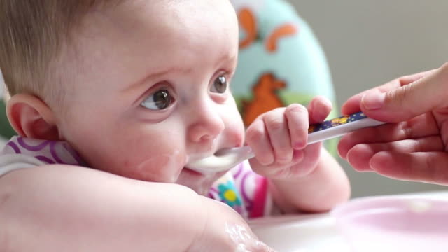 a baby girl having her first milk and food - 6 11 months stock videos & royalty-free footage