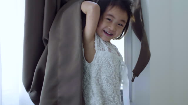 baby girl hiding behind the curtain - blanket stock videos & royalty-free footage