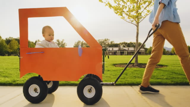 baby girl in a homemade orange car - dressing up stock videos & royalty-free footage