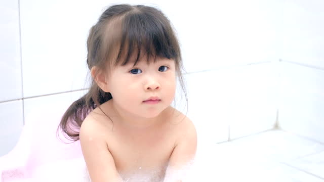 baby girl in bathtub - ugliness stock videos and b-roll footage