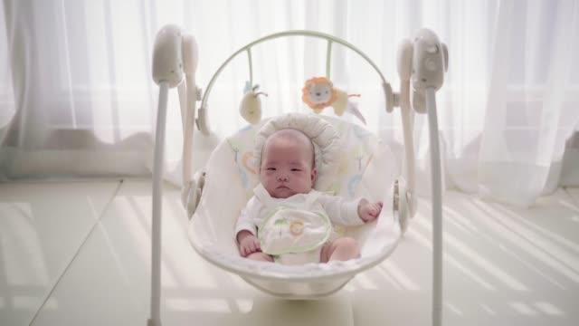 vídeos y material grabado en eventos de stock de baby girl in her rocking chair - balancearse