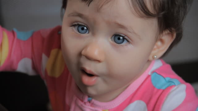 cu baby girl (6-11 months) in playpen blowing kisses / miami, florida, usa - 6 11 months stock-videos und b-roll-filmmaterial