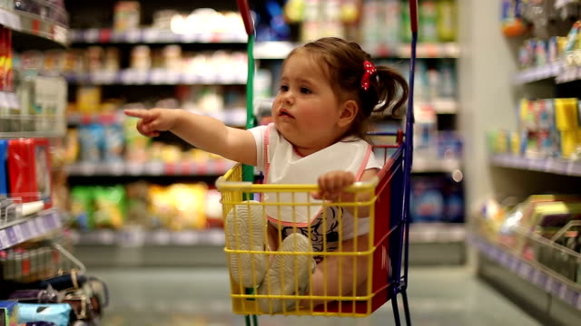 baby girl in shopping cart sitting and demanding - pointing stock videos & royalty-free footage