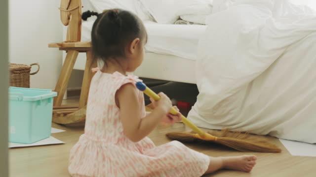 baby girl is sweeping floor - housework stock videos & royalty-free footage