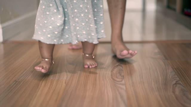 baby girl learns to walk indoor - effort stock videos & royalty-free footage
