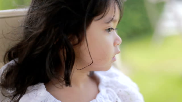 baby girl looking out from car - human hair stock videos & royalty-free footage