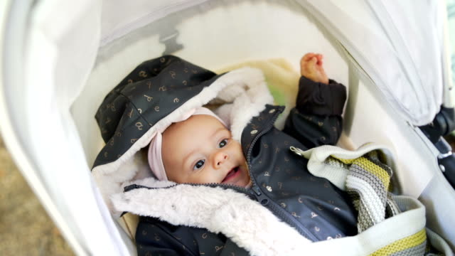 baby girl lying in a stroller - pushchair stock videos & royalty-free footage