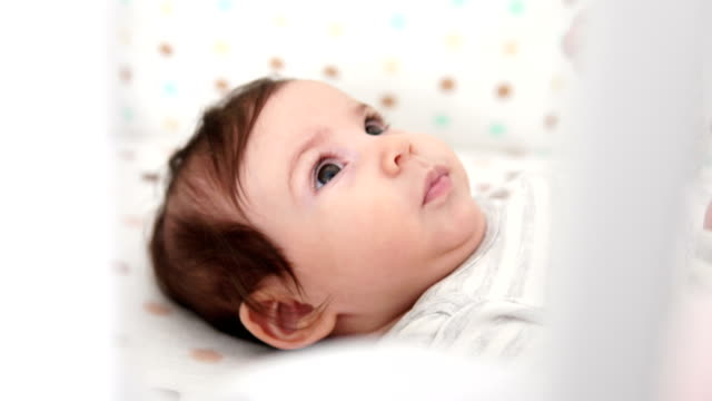 baby girl lying on back in nursery - lying on back stock videos & royalty-free footage