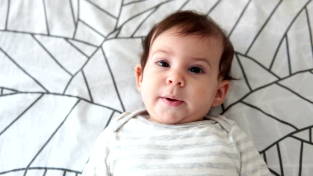 baby girl lying on back on bed - lying on back stock videos & royalty-free footage