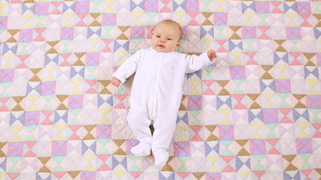 ms baby girl (6-11 months) lying on fabric / brussels, belgium - 6 11 months stock videos & royalty-free footage