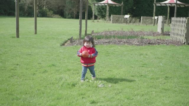 baby girl play ball at spring park - one baby girl only stock videos & royalty-free footage