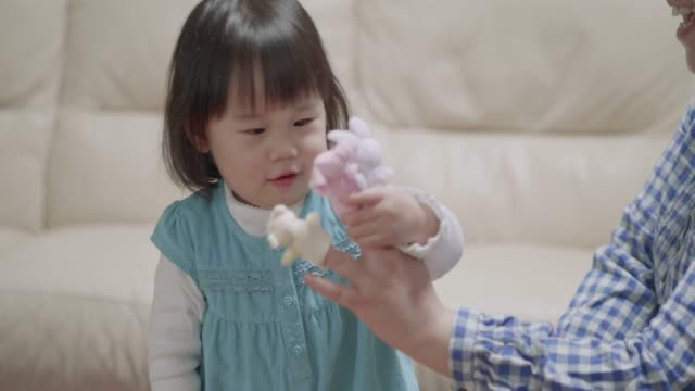 baby girl play puppet at home