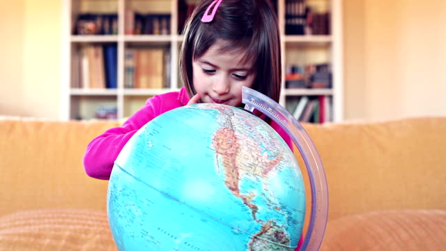 HD Baby girl play with a globe