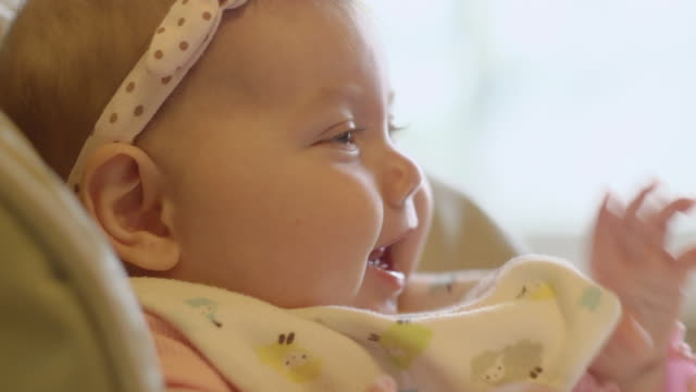 vídeos y material grabado en eventos de stock de ecu baby girl playing and laughing / ann arbor, michigan, united states - ann arbor