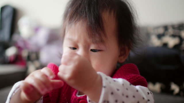 baby girl playing at home - coffee table stock videos & royalty-free footage