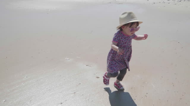 baby girl playing at summer beach,donegal,ireland - baby girls stock videos & royalty-free footage