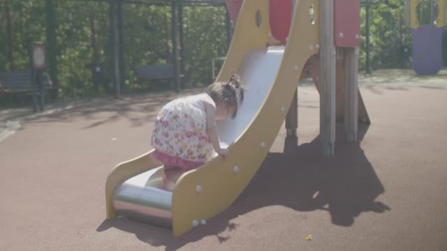 baby girl playing at summer playground - parco giochi video stock e b–roll