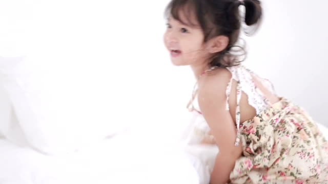 baby girl playing in bed - cute stock videos & royalty-free footage