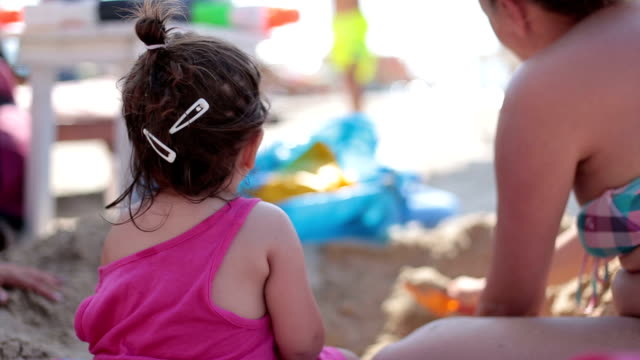baby girl playing in the sand with her mother and aunt - aunt stock videos & royalty-free footage