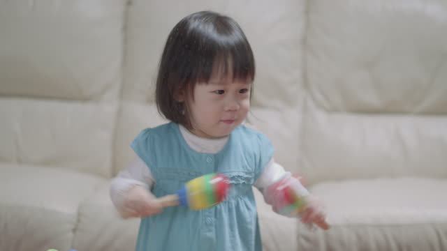 baby girl playing maracas - maraca stock videos & royalty-free footage