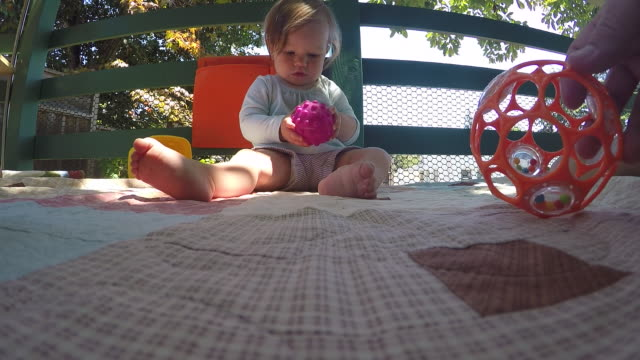 a baby girl playing outdoors on the porch of a house. - modern manhood stock videos & royalty-free footage