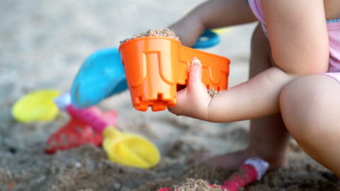 baby girl playing sand on the beach. - 2 3 years stock videos & royalty-free footage