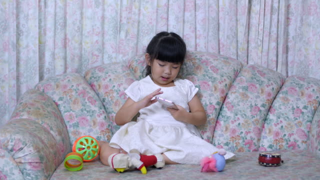 baby girl playing smartphone - tights stock videos & royalty-free footage