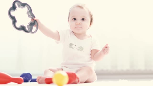 baby girl playing toys - babygro stock videos & royalty-free footage
