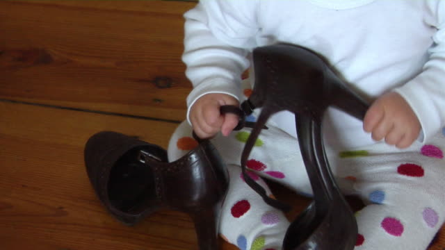 cu ha baby girl (6-11 months) playing with pair of shoes, berlin, germany - 6 11 months stock videos & royalty-free footage