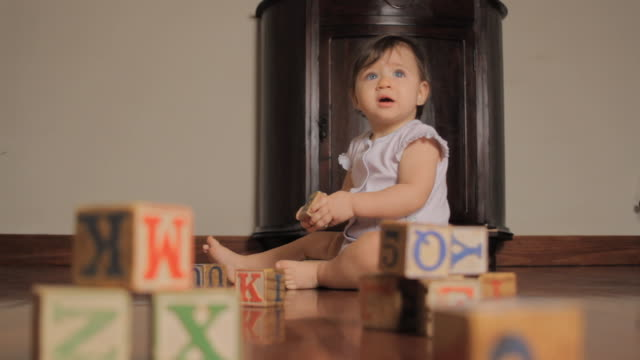 ws baby girl (6-11 months) playing with wooden blocks on floor / miami, florida, usa - block shape stock videos & royalty-free footage